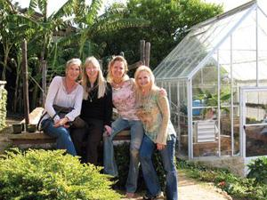 Members of the Malibu Agricultural Society—from left, Traci Donat, Kathryn Hagopian, June Louks and Monique Guild—at the home of Louks, which features a fully functioning organic garden. Paul Sisolak / TMT
